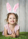 Little girl with Easter eggs. On the background of wooden wall Royalty Free Stock Photos