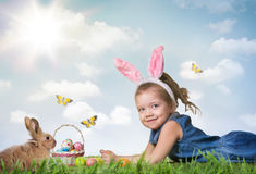 Little girl with Easter eggs. On the grass Royalty Free Stock Photo