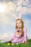 Little girl with Easter eggs. On the grass Stock Image