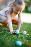 Little girl on Easter eggs hunt stock images