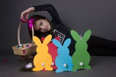 Little girl with Easter eggs. And bunnies decoration celebration children Stock Image