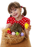 Little girl with easter rabbit and easter eggs. Happy little girl with easter rabbit and easter eggs Stock Images