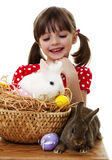 Little girl with easter rabbits Royalty Free Stock Photography