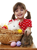 Little girl with easter rabbits and easter eggs. Happy little girl with easter rabbits and easter eggs Stock Image