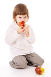 The little girl eat apples Royalty Free Stock Photography