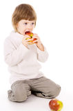 The little girl eat apples Royalty Free Stock Photos