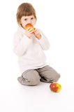 The little girl eat apples Stock Photos