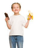 Little girl eat banana and chocolate Stock Photo