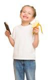 Little girl eat banana and chocolate Stock Photos