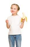 Little girl eat banana Stock Image