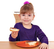Little girl eat bread with chocolate Royalty Free Stock Images