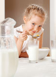 Little girl eat breakfast Stock Images