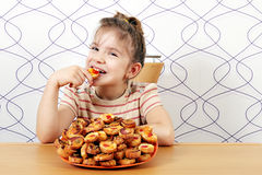 Little girl eat bruschette Royalty Free Stock Photo