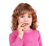 Little girl eat cake Stock Image