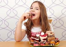 Little girl eat cake. Happy little girl eat cake royalty free stock images