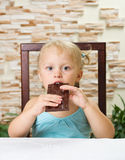 Little girl eat chocolate Stock Photos