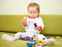 Little girl eat chocolate Royalty Free Stock Photos
