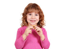 Little girl eat cookie Stock Image