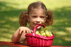 Little girl eat grape Royalty Free Stock Photography