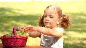 Little girl eat grape stock video