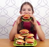 Little girl eat hamburger Stock Photography