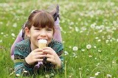 Little girl eat ice cream Stock Photography