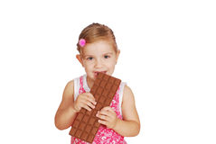 Little girl eat large chocolate Stock Photos