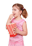 Little girl eat popcorn Royalty Free Stock Images
