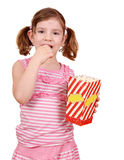Little girl eat popcorn Stock Photos