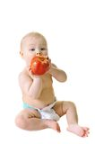 Little girl eat ripe red apple Royalty Free Stock Image