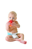 Little girl eat ripe red apple Stock Photos