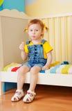 Little girl eat some snacks Stock Image