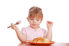 Little girl eat spaghetti Stock Images
