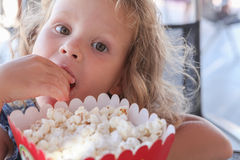 Little girl eat sweet popcorn Royalty Free Stock Photography