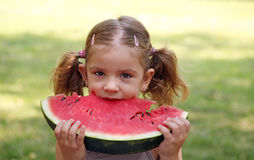 Little girl eat watermelon Royalty Free Stock Image