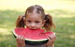 Little girl eat watermelon Royalty Free Stock Image