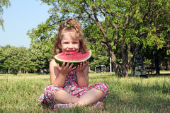 Little girl eat watermelon Royalty Free Stock Images