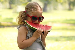 Little girl with eat watermelon Royalty Free Stock Photo