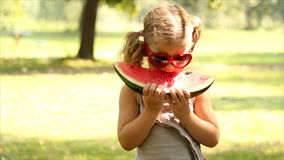 Little girl with eat watermelon stock video footage