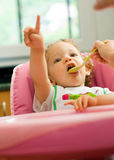 Little girl eating Stock Photo