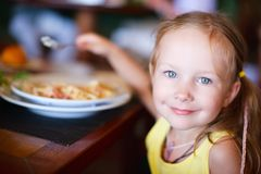 Little girl eating Royalty Free Stock Images