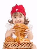 Little Girl Eating A Loaf Of Bread Royalty Free Stock Photo
