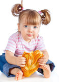 Little Girl Eating A Loaf Of Bread Stock Photos