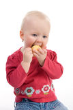 Little girl eating apple. Little girl holding an apple Royalty Free Stock Photography