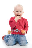 Little girl eating an apple. Little girl holding an apple Stock Photo