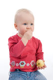 Little girl eating apple. Little girl holding an apple Stock Photo
