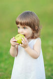 Little girl eating an apple Royalty Free Stock Photo