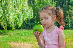 Little girl eating apple Royalty Free Stock Photography