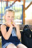 Little girl eating apple. Healthy nutrition. Little girl is eating an apple. Healthy nutrition. Pretty child eating an apple at park , nature outdoors. Teenager stock images
