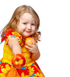 Little girl eating apples Royalty Free Stock Photo